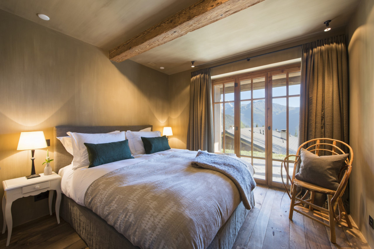 Double bedroom with views from terrace at Chalet Aline in Verbier