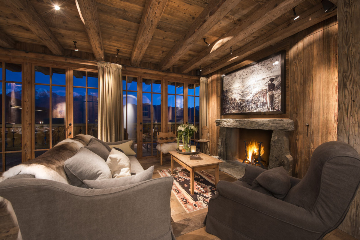 Cozy lounge with night time views at Chalet Aline in Verbier