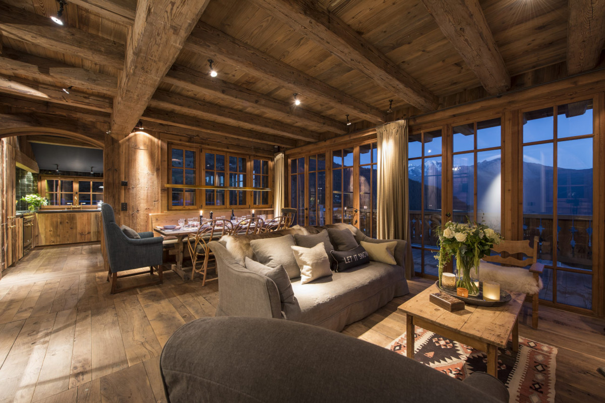 Lounge dining room evening ambience at Chalet Aline in Verbier
