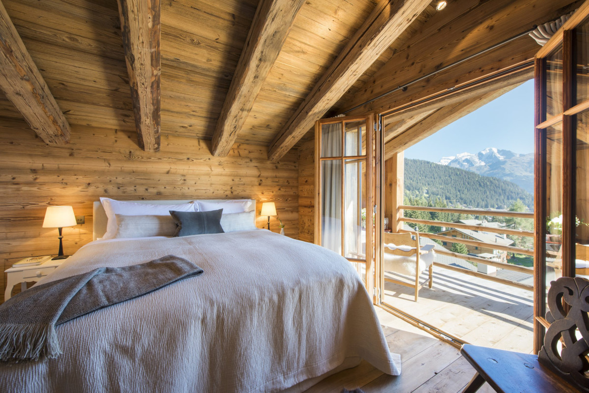 Master bedroom with majestic views at Chalet Aline in Verbier