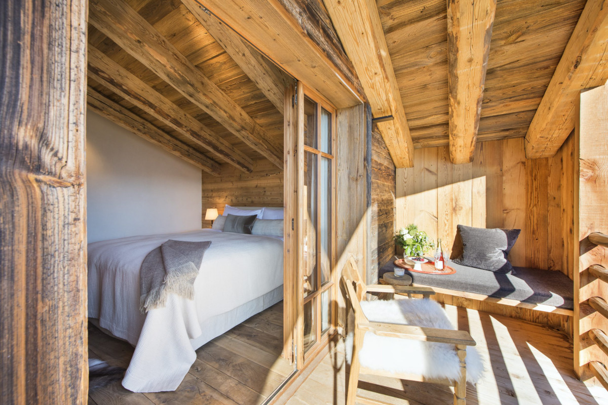 Master bedroom with private terrace at Chalet Aline in Verbier
