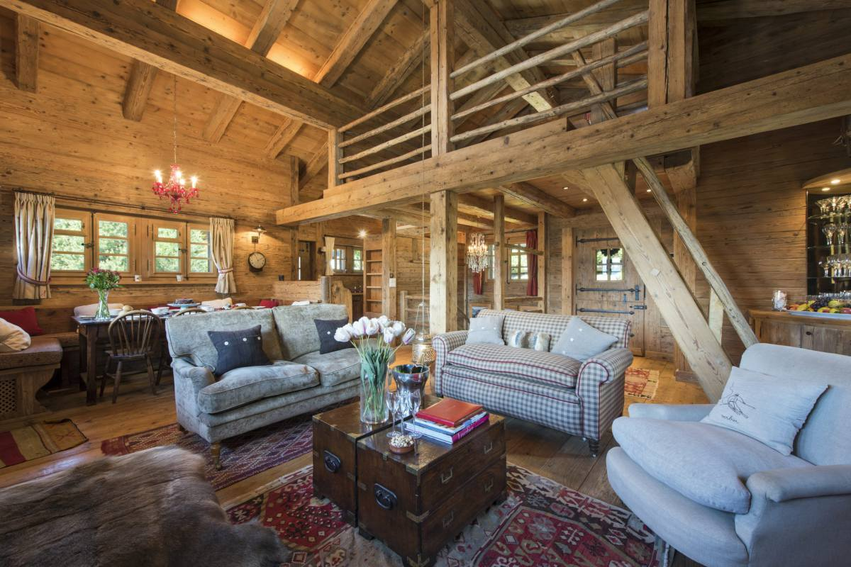 Open-plan living room with mezzanine in Chalet Le Ti at Bella Coola Estate in Verbier