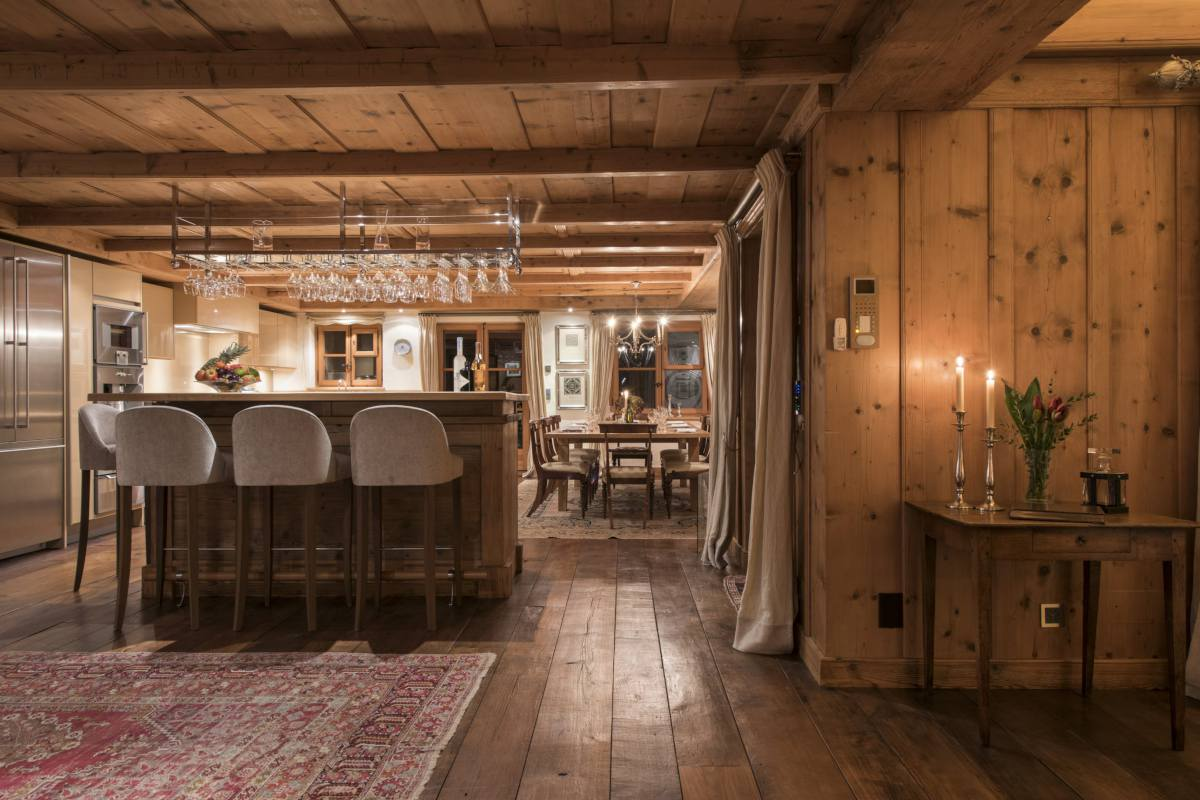 Central bar with views into dining area at Chalet Bella Coola in Verbier