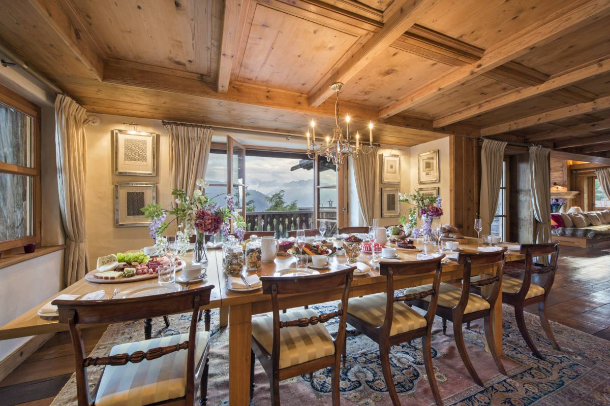 Dining area opening onto terrace at Chalet Bella Coola in Verbier