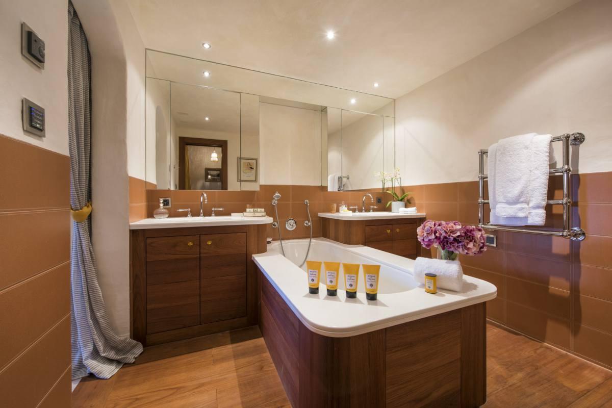 En suite bathroom with island bathtub at Chalet Bella Coola in Verbier
