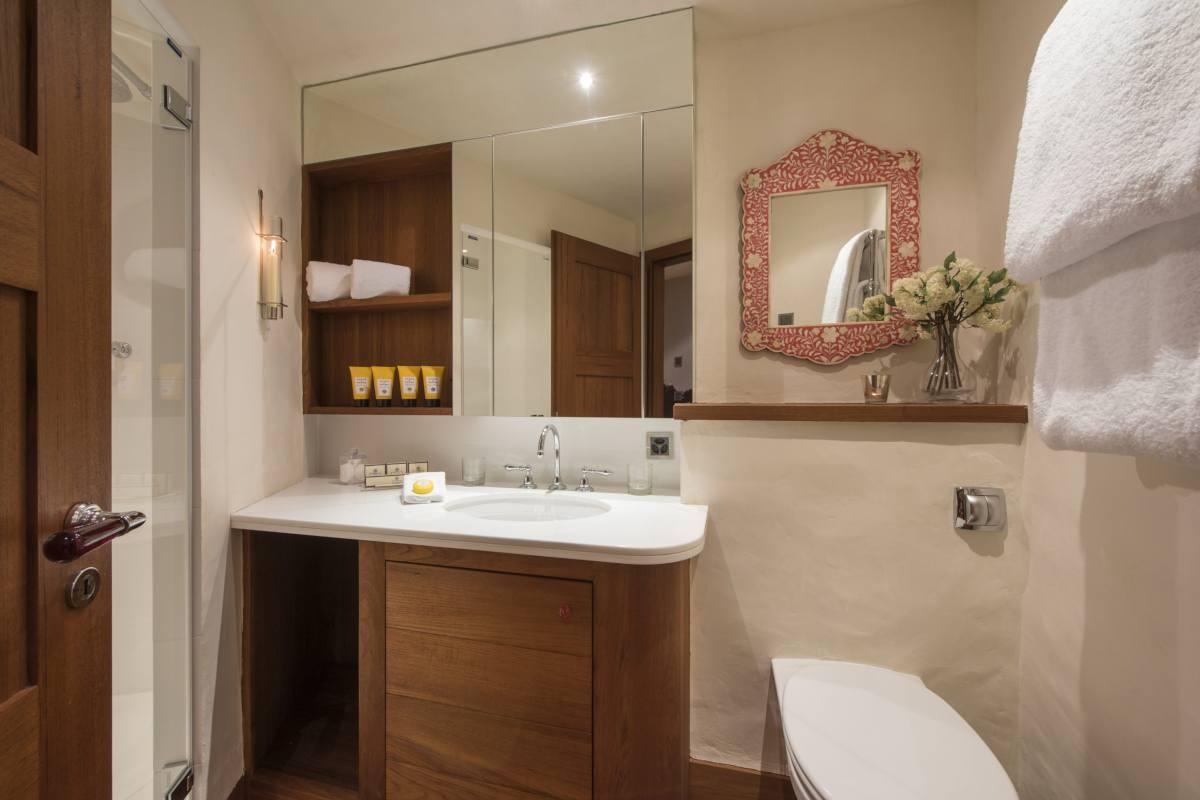 En suite shower room at Chalet Bella Coola in Verbier