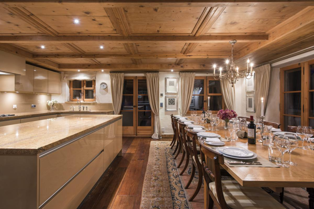 Kitchen overlooking dining area at Chalet Bella Coola in Verbier