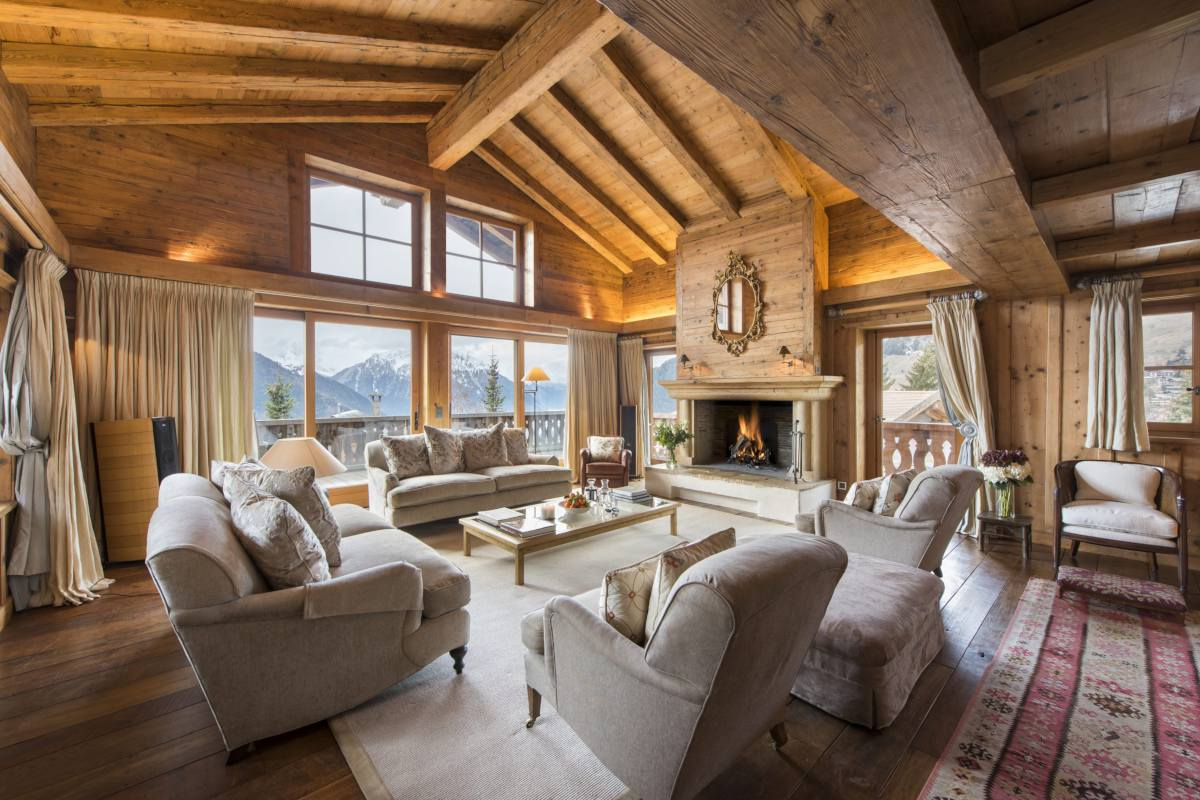 Living room with mountain views and fireplace at Chalet Bella Coola in Verbier