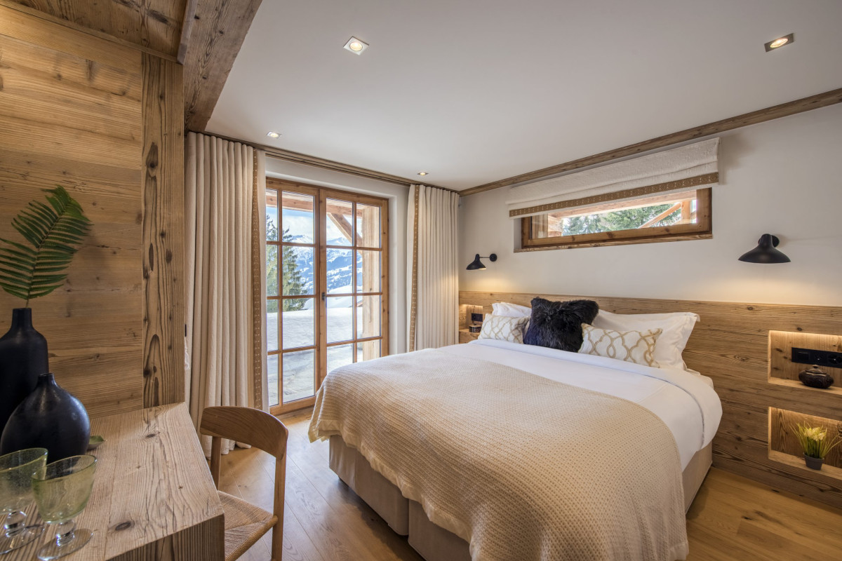 Double bedroom with terrace and views at Chalet Bioley in Verbier