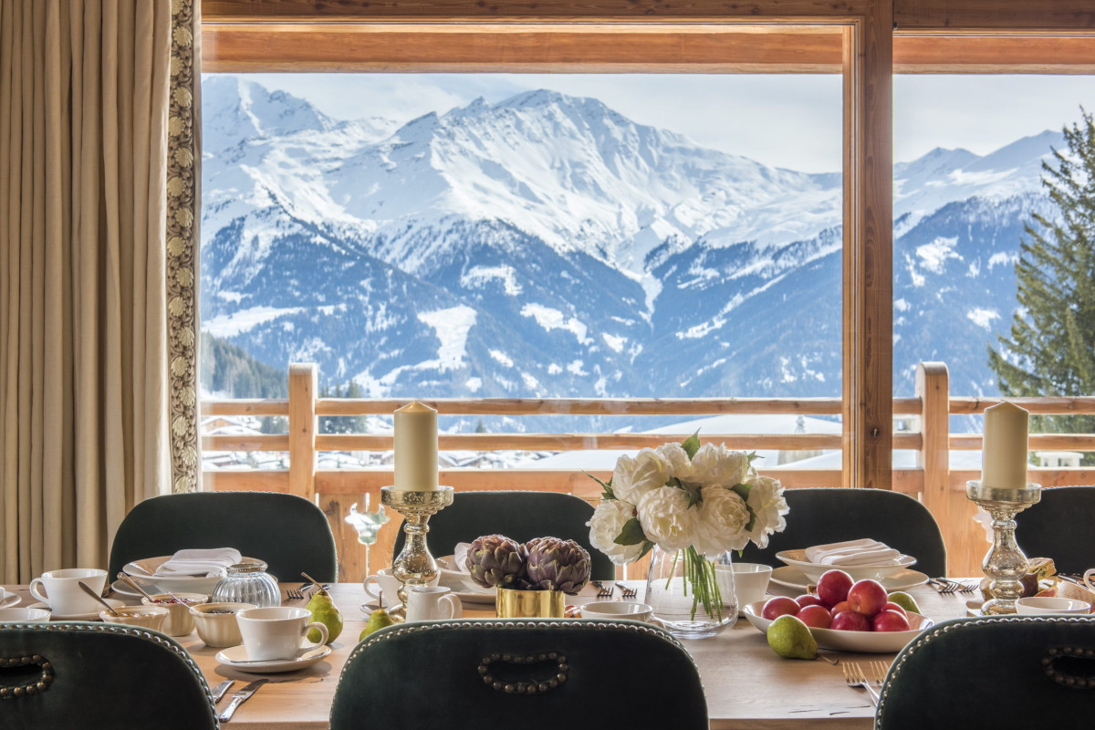 Dining table incredible Rogneux mountain views at Chalet Bioley in Verbier