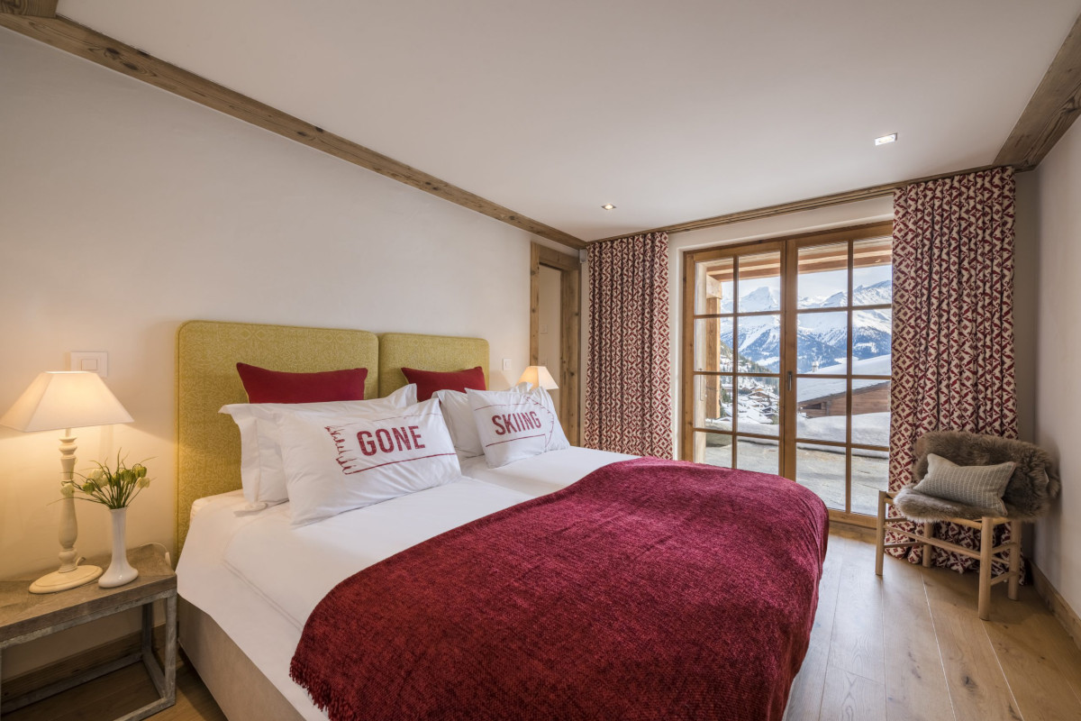 Double ensuite bedroom with mountain views at Chalet Bioley in Verbier