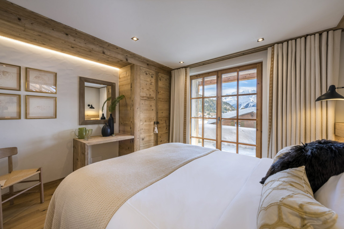 Double bedroom with mountain views and terrace access at Chalet Bioley in Verbier