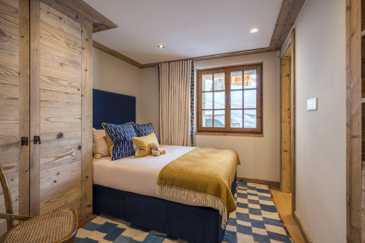 Family suite double bed at Chalet Bioley in Verbier