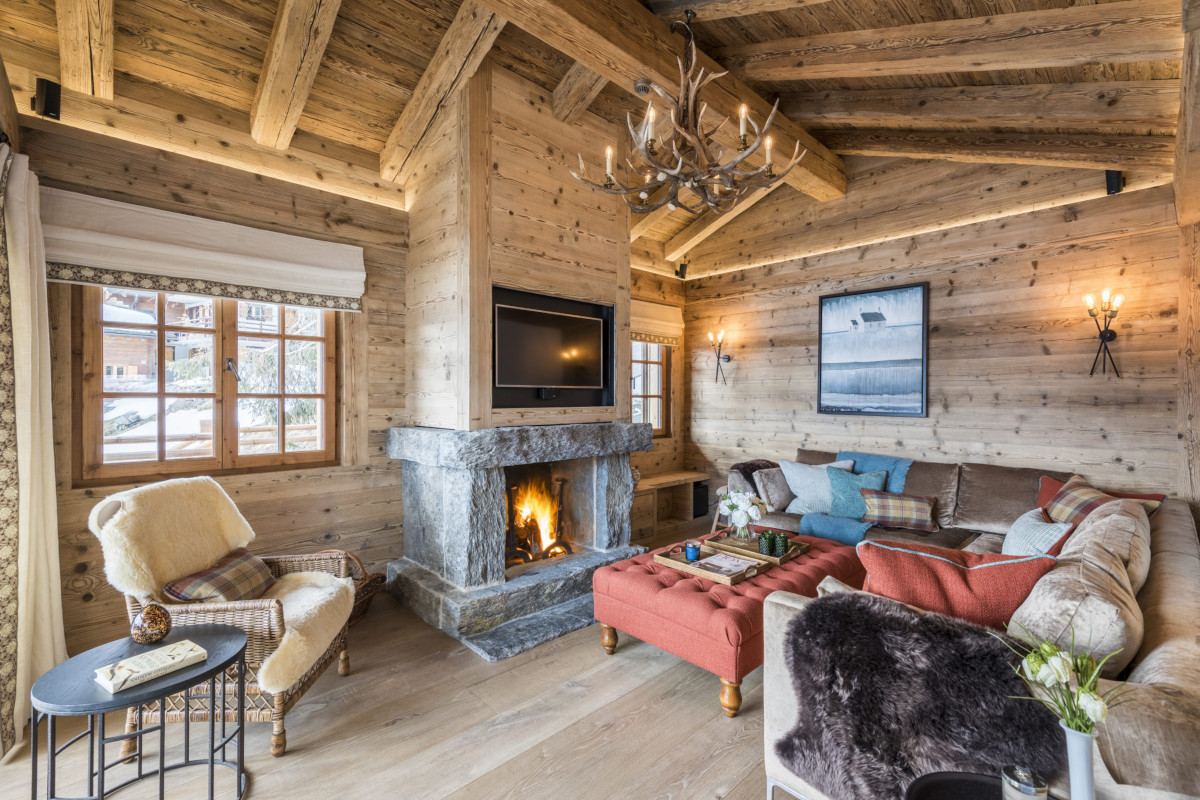 Cozy fireplace scene at Chalet Bioley in Verbier