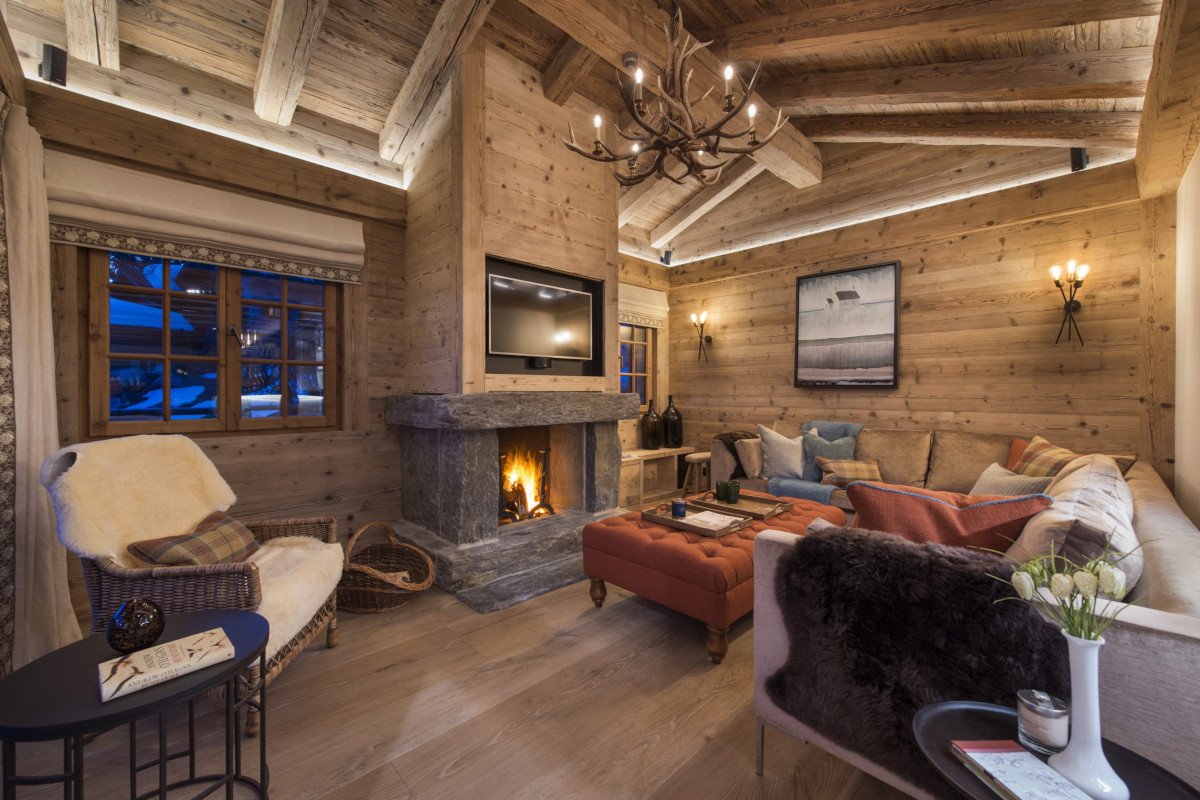 Lounge open fire at Chalet Bioley in Verbier