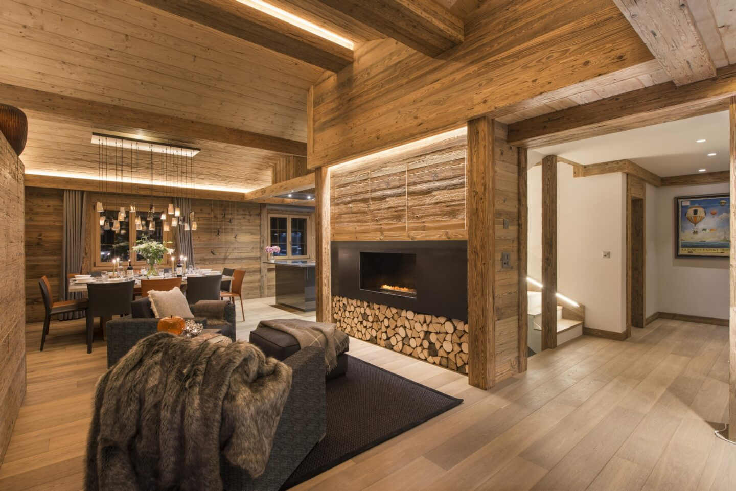 Open fire and dining space at Chalet Daphne in Verbier