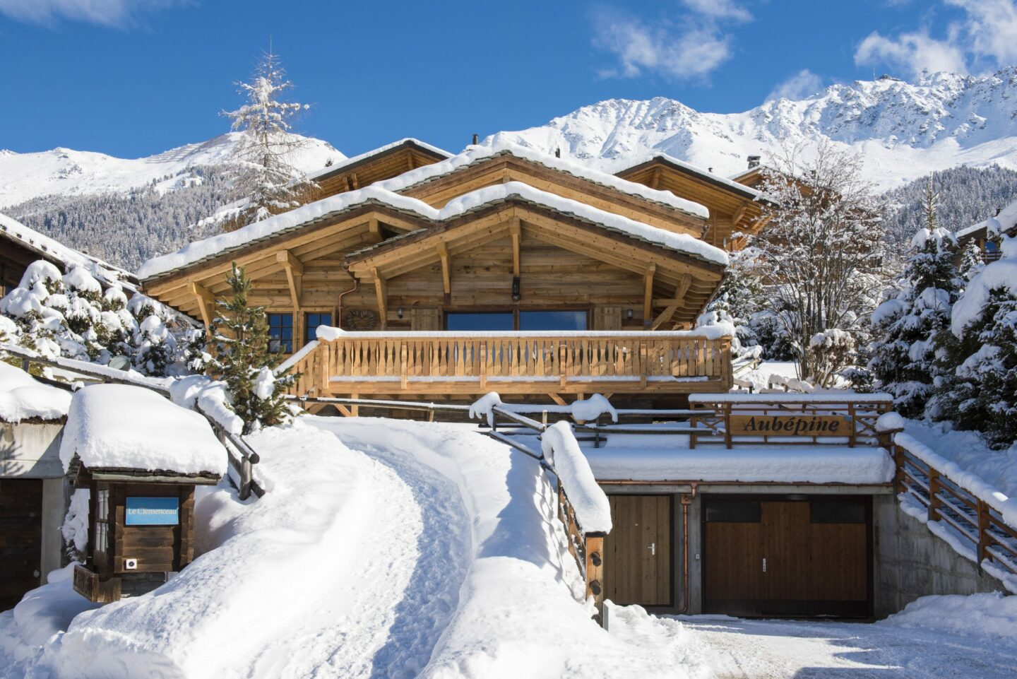 Exterior with snow and Atlas ski slopes in background at Chalet Daphne in Verbier