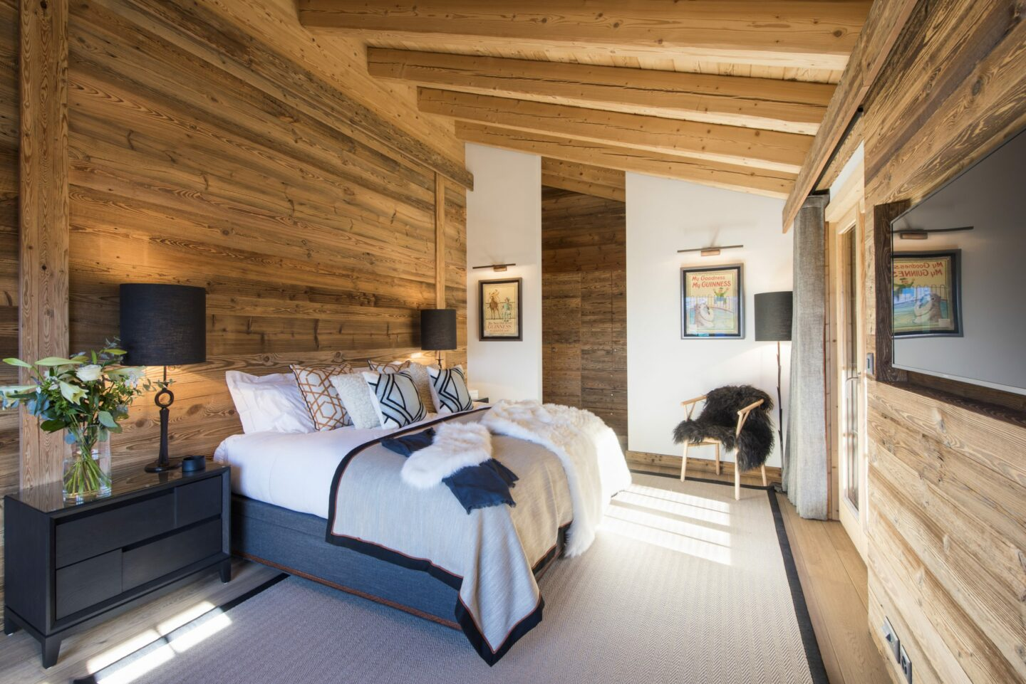 Master bedroom with private terrace at Chalet Daphne in Verbier