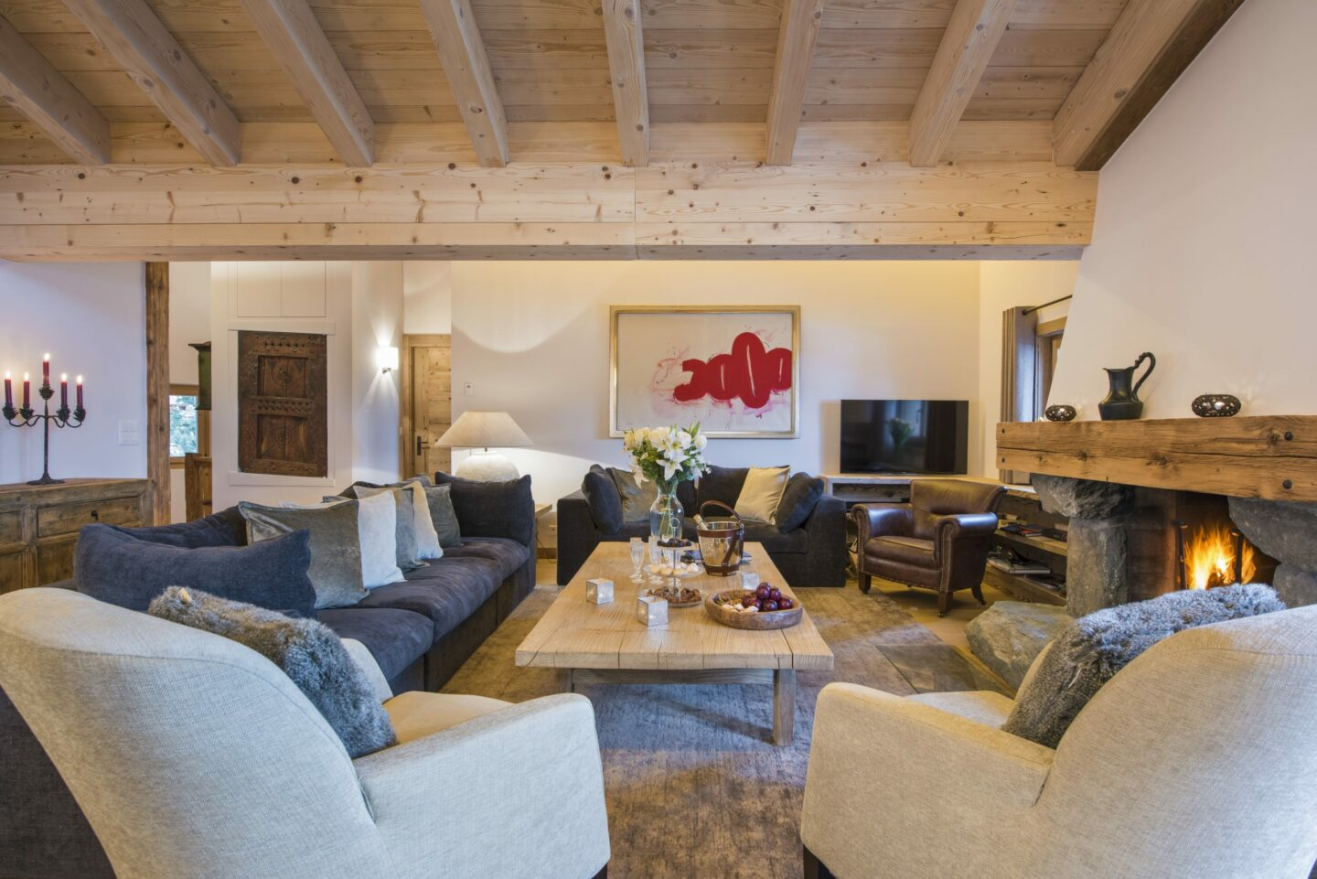 Lounge and open fire at Chalet Delormes in Verbier