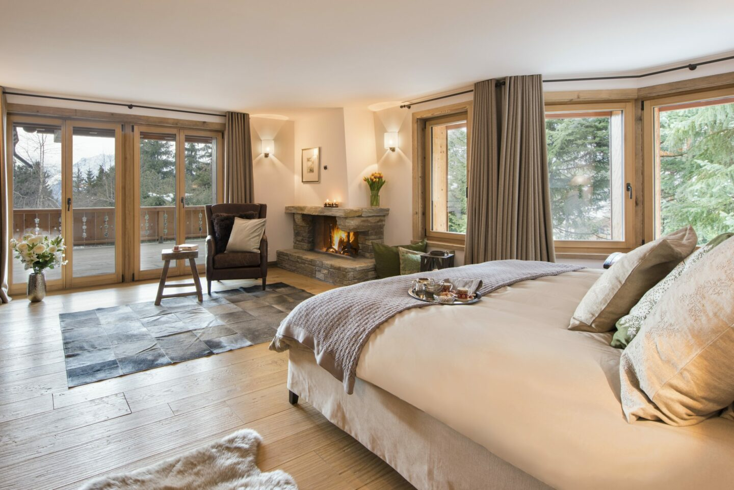 Master bedroom with balcony at Chalet Delormes in Verbier