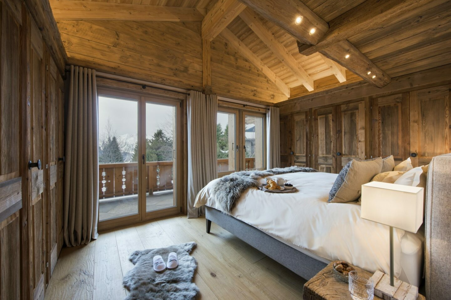 Double bedroom with balcony at Chalet Delormes in Verbier