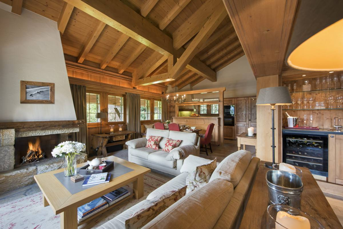 Open-plan living area with wood burning fireplace at Apartment Ivouette in Verbier