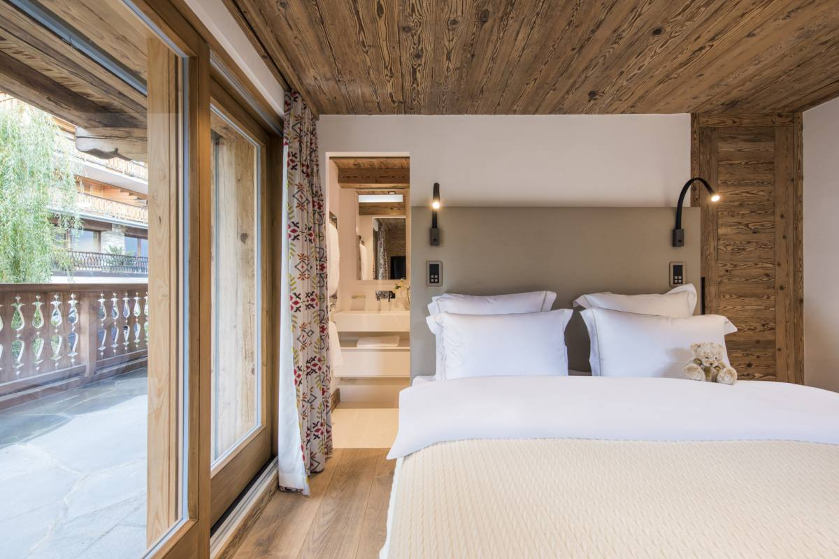 First floor double bedroom with view into en suite shower room at Chalet La Datcha in Verbier