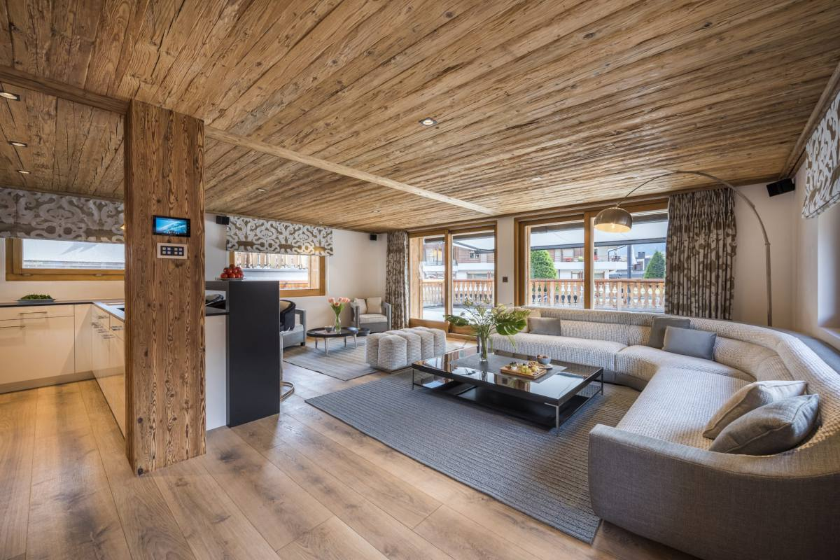Open-plan living area at Chalet La Datcha in Verbier