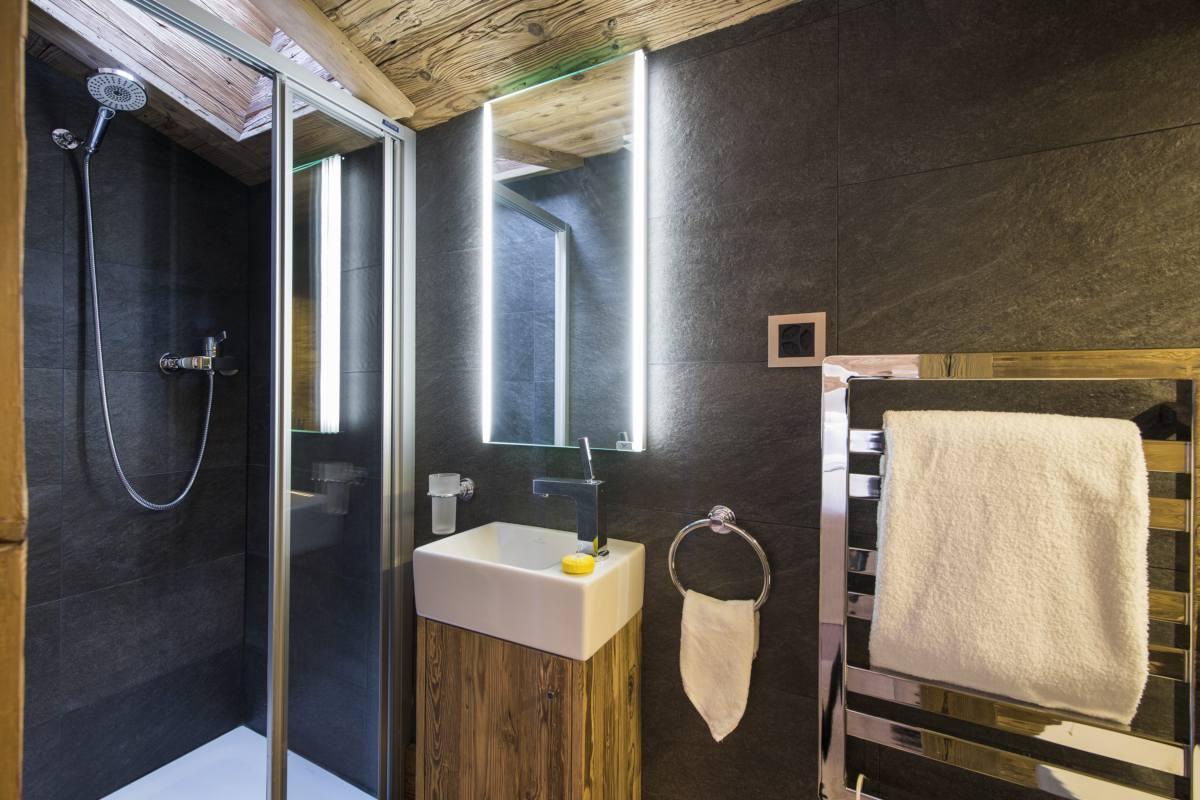 Top floor en suite shower room at Chalet La Datcha in Verbier