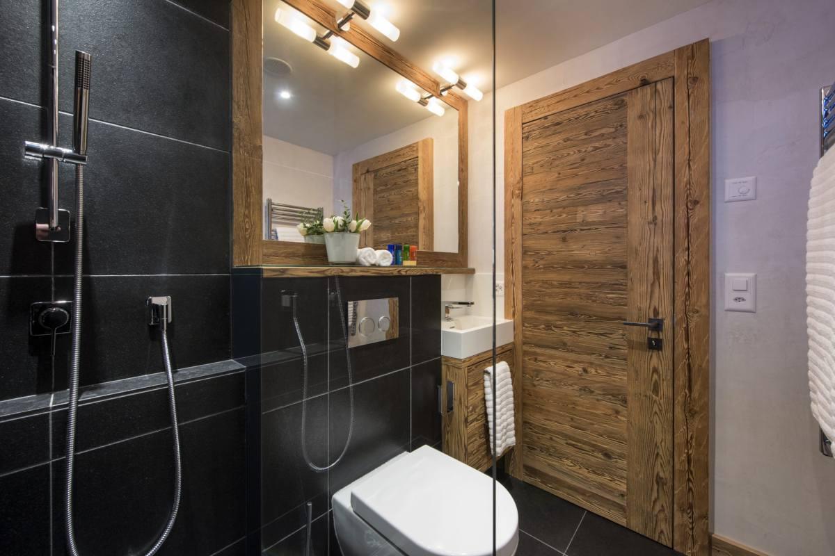 En suite shower room at Chalet La Vigne in Verbier