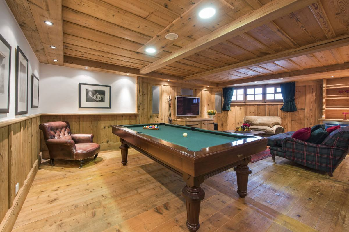 Ground floor games and TV room with pool table at Chalet Le Ti in Verbier