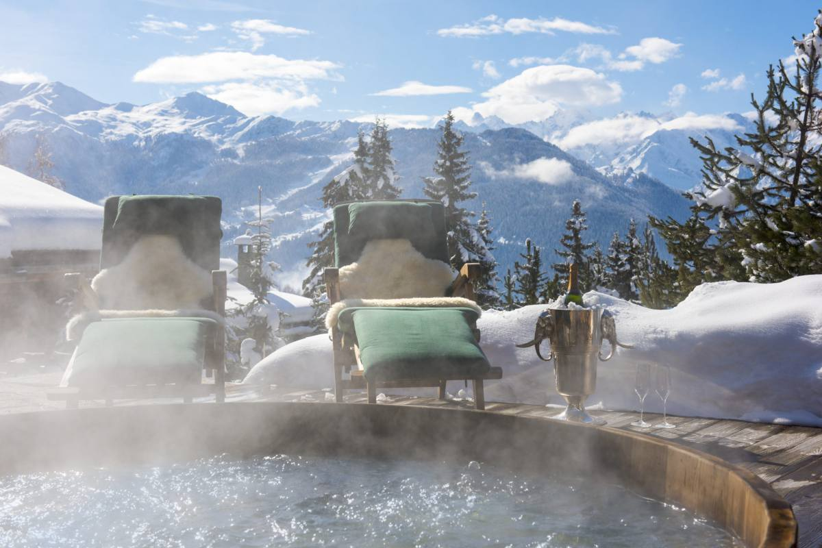 Outdoor hot tub with mountains in background at Chalet Le Ti in Verbier