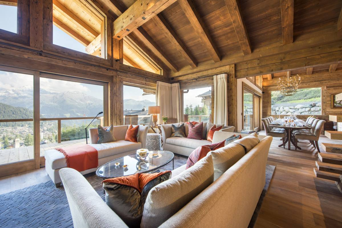 Living and dining area with mountain views at Chalet Les Etrennes in Verbier