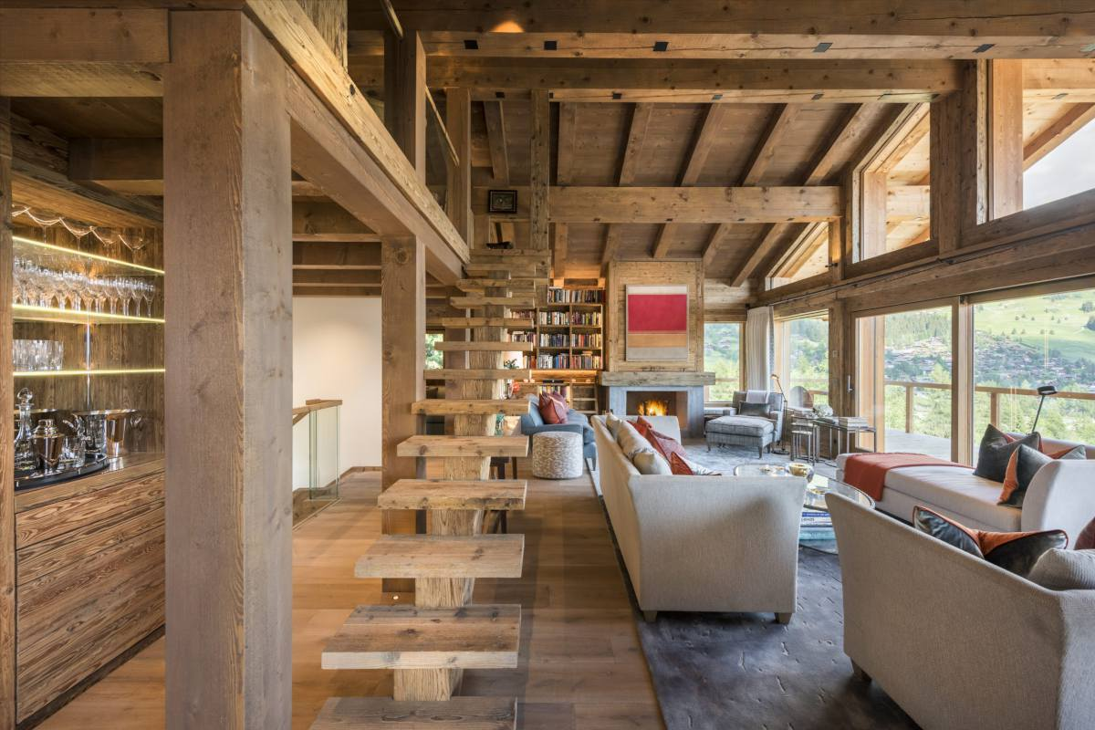 Open-plan living room with mountain views at Chalet Les Etrennes in Verbier