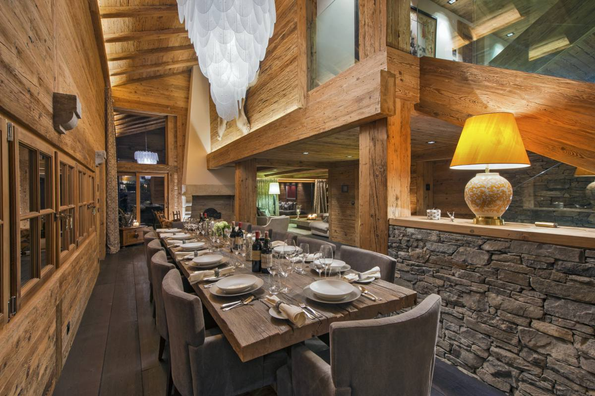 Dining table set under chandelier lighting at Chalet Makini in Verbier