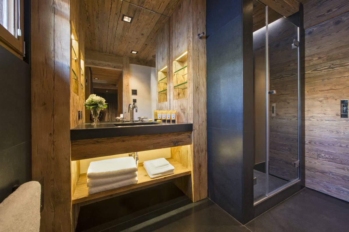 En suite shower room at Chalet Makini in Verbier