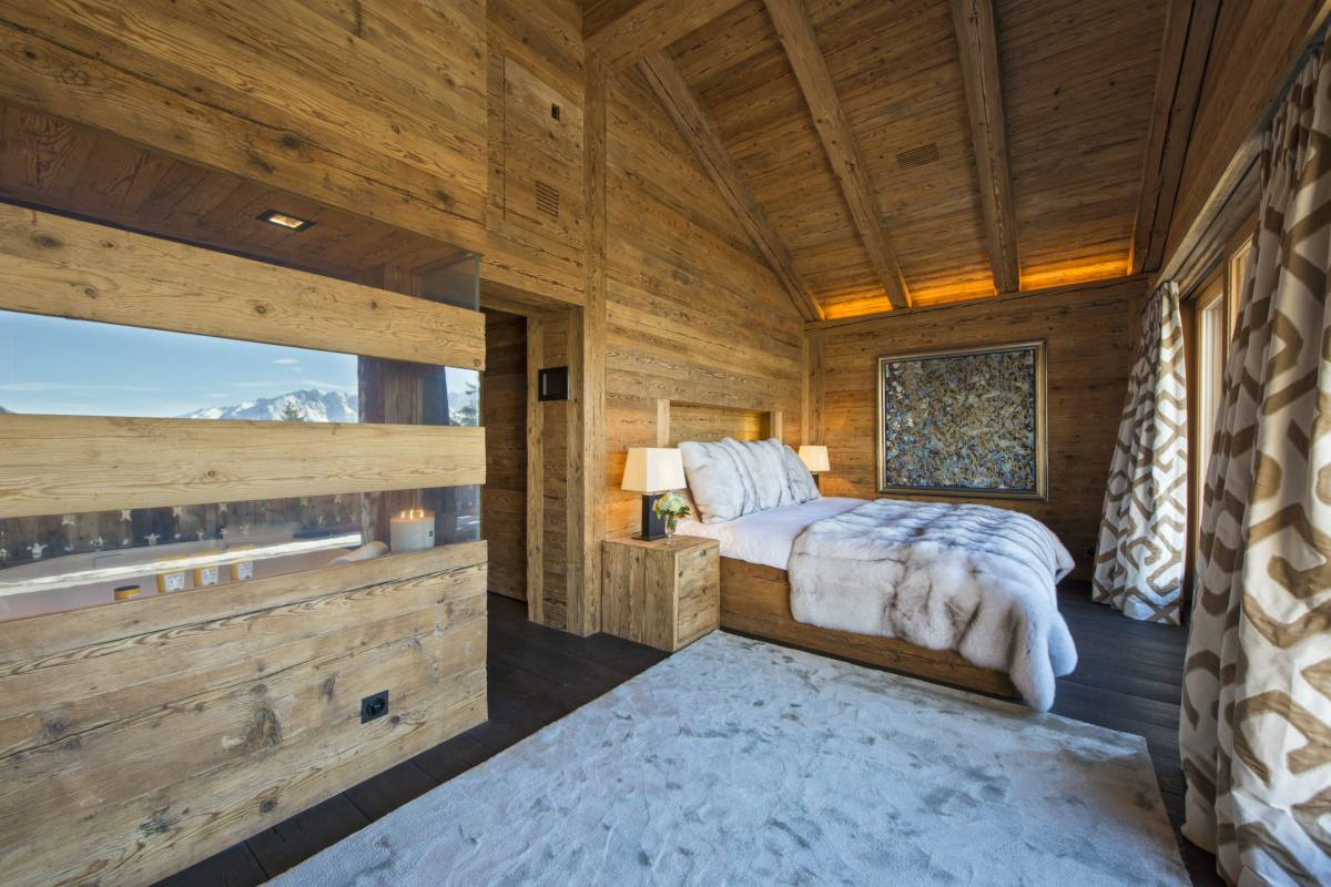 Master bedroom with beautiful views at Chalet Makini in Verbier