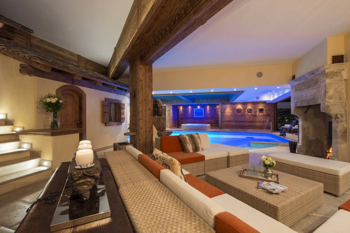 Spa lounge with wood burning fireplace at Chalet Makini in Verbier