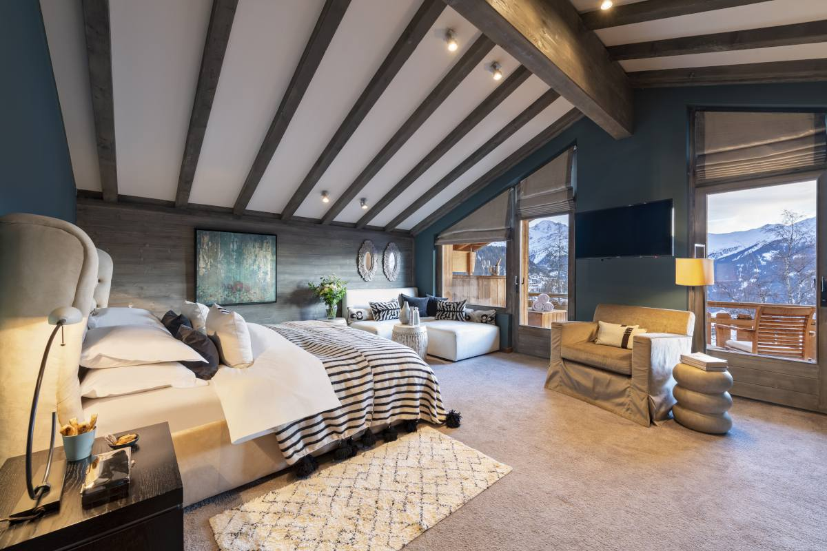 Fourth floor master suite with balcony access at No. 14 Verbier
