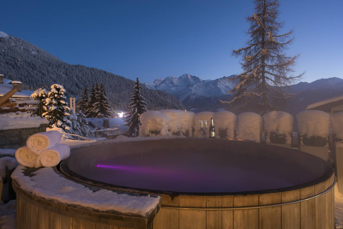 Outdoor hot tub with mountain views at No. 14 Verbier