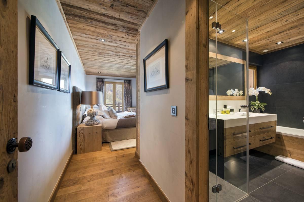 En suite bathroom and view into double bedroom at Chalet Norte in Verbier