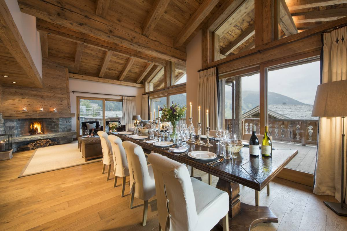 Dining table with mountain views at Chalet Sirocco in Verbier