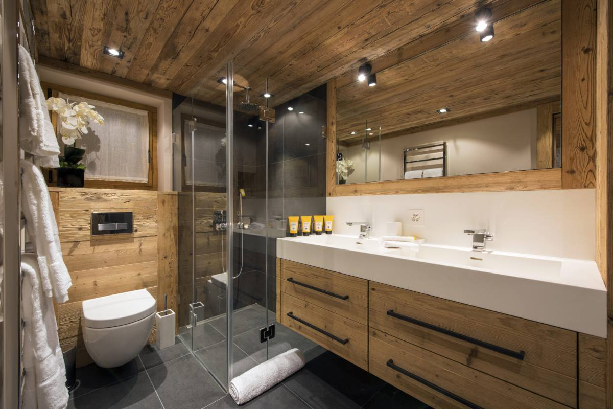 En suite bathroom showing separate shower and double sinks at Chalet Sirocco in Verbier