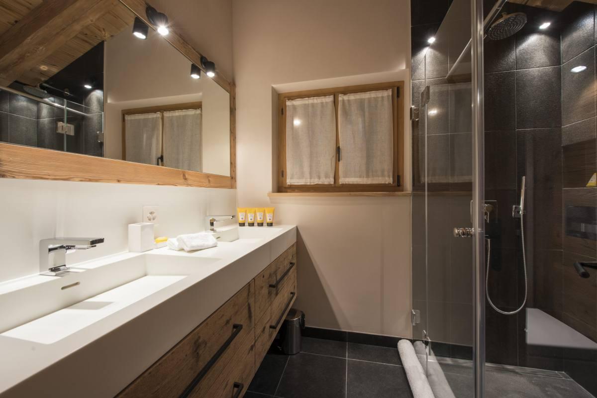En suite shower room at Chalet Sirocco in Verbier