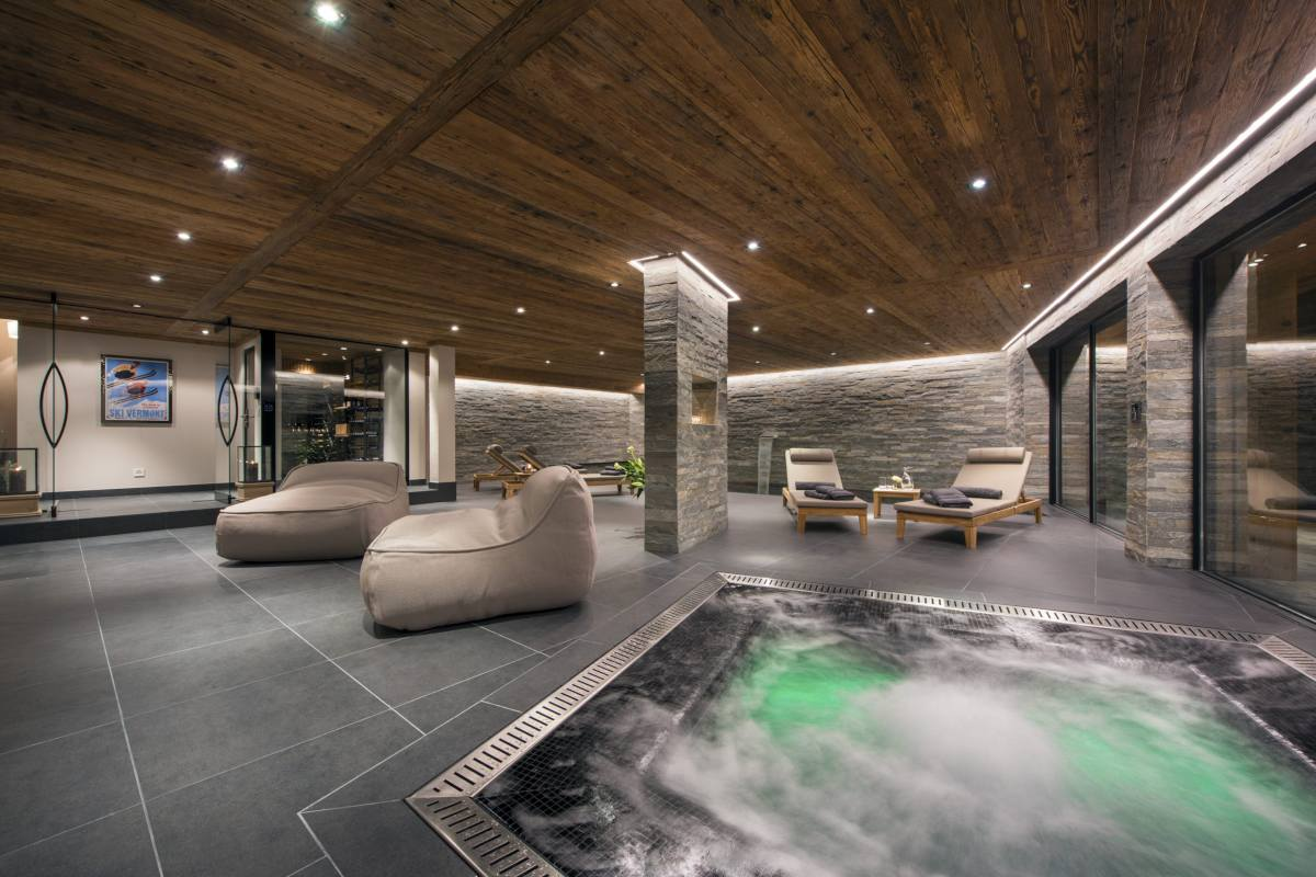 Indoor hot tub and relaxation area at Chalet Sirocco in Verbier