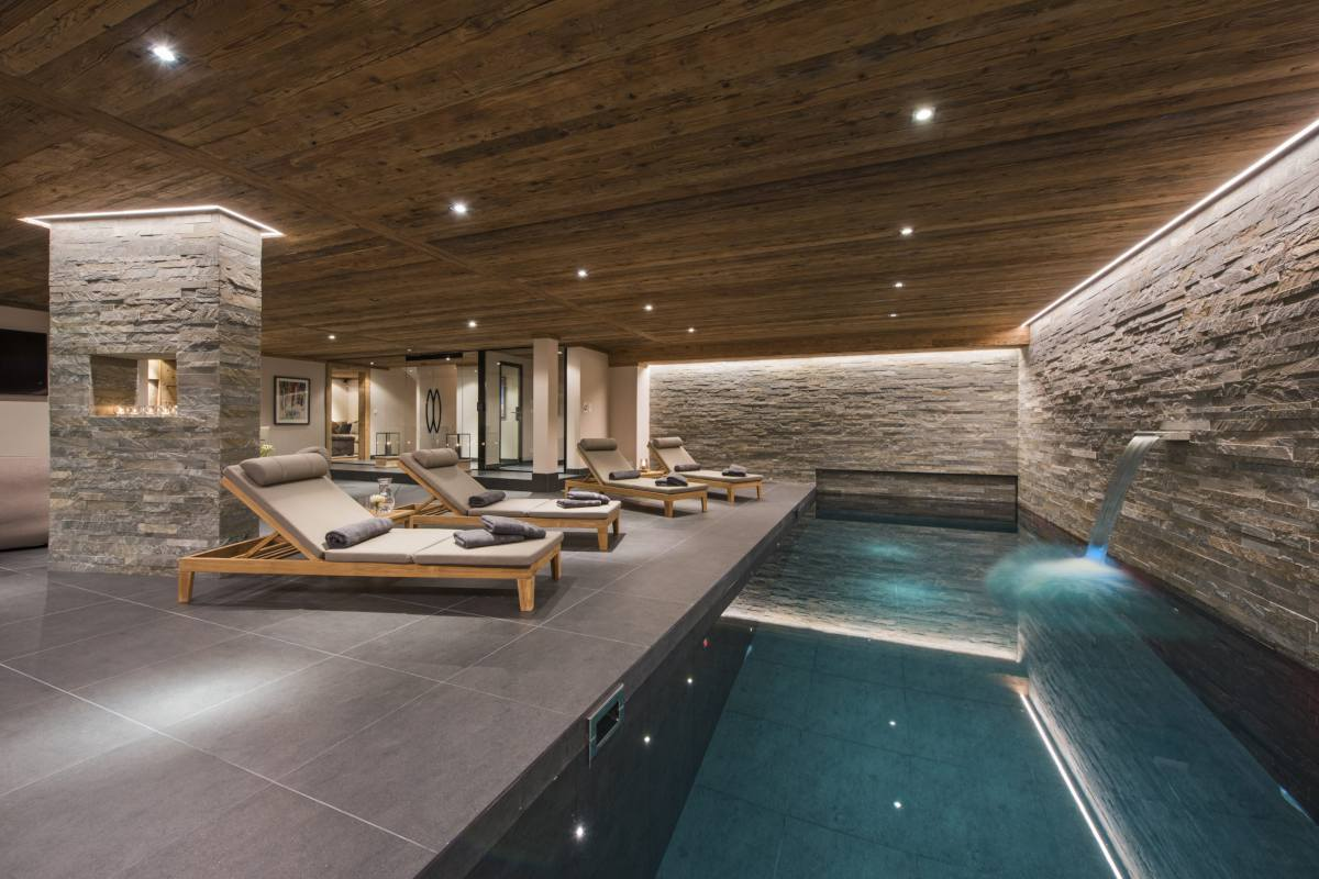 Indoor swimming pool and relaxation area at Chalet Sirocco in Verbier