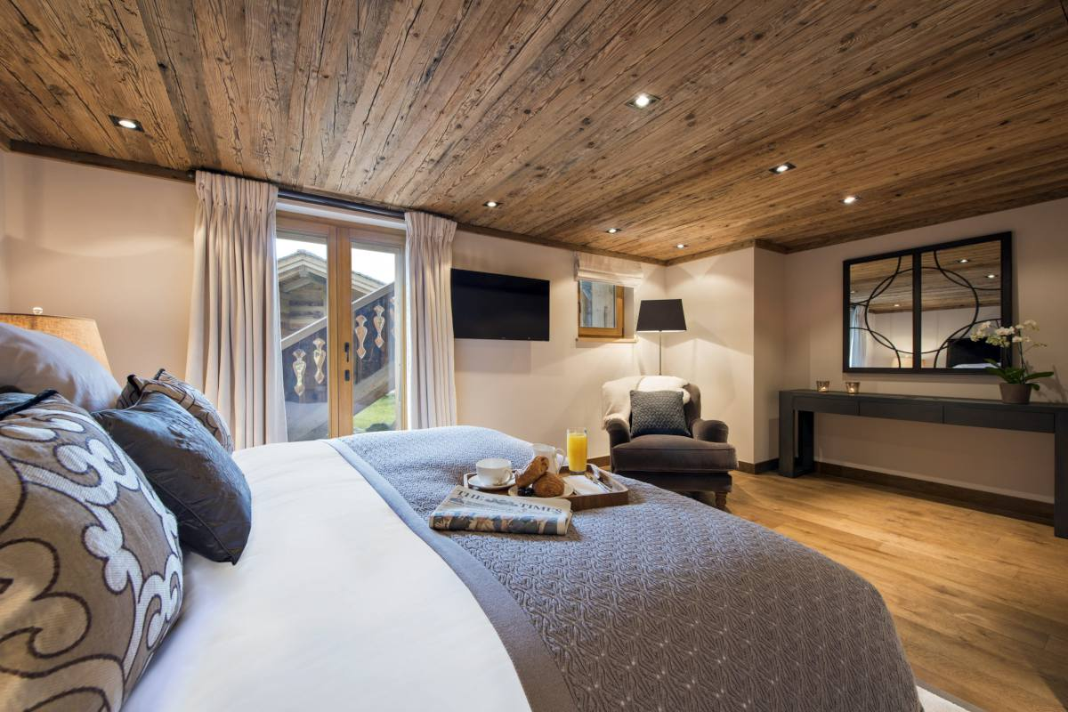 Master bedroom with terrace access at Chalet Sirocco in Verbier