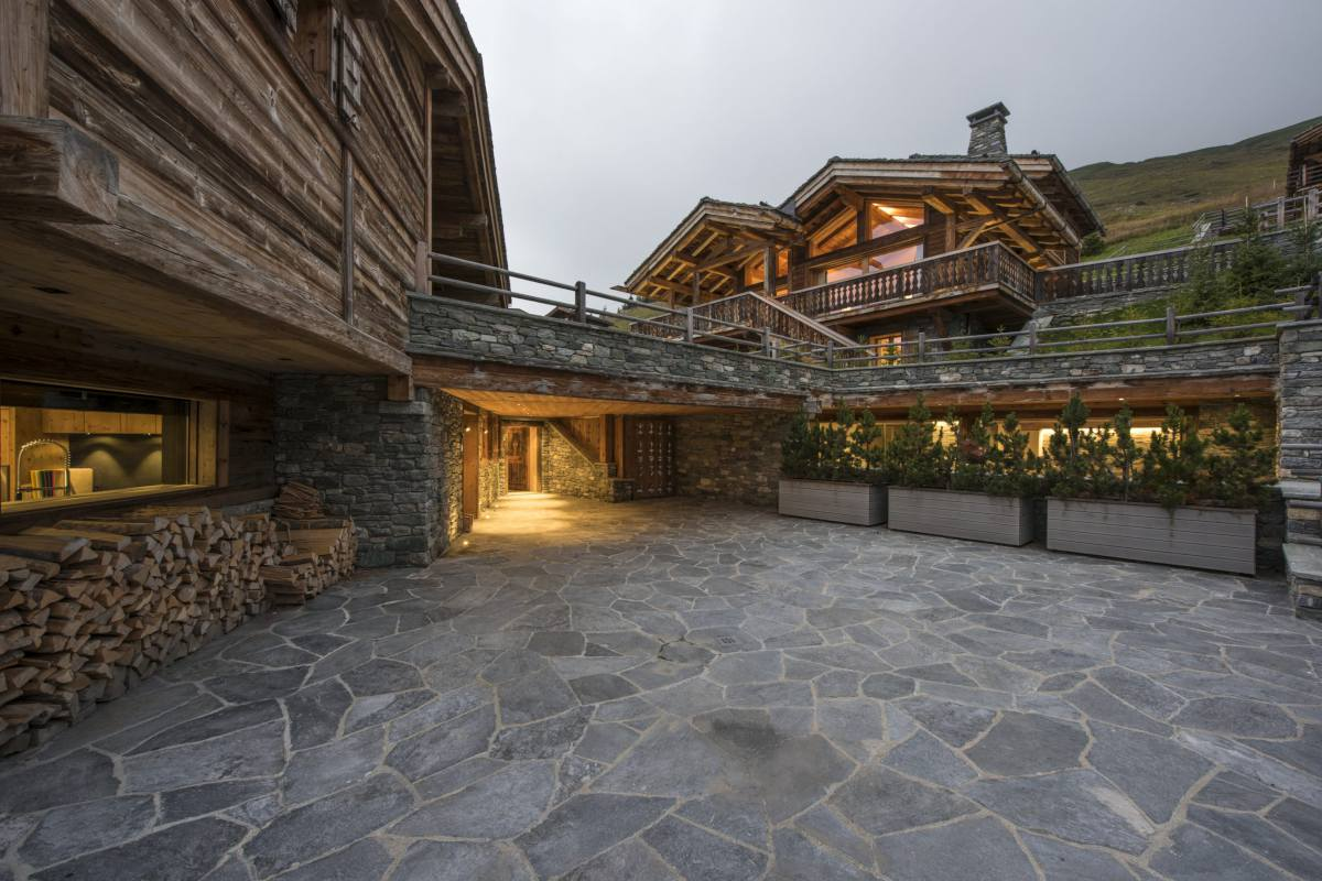 Connecting terrace and exterior of chalets that make up The Alpine Estate in Verbier