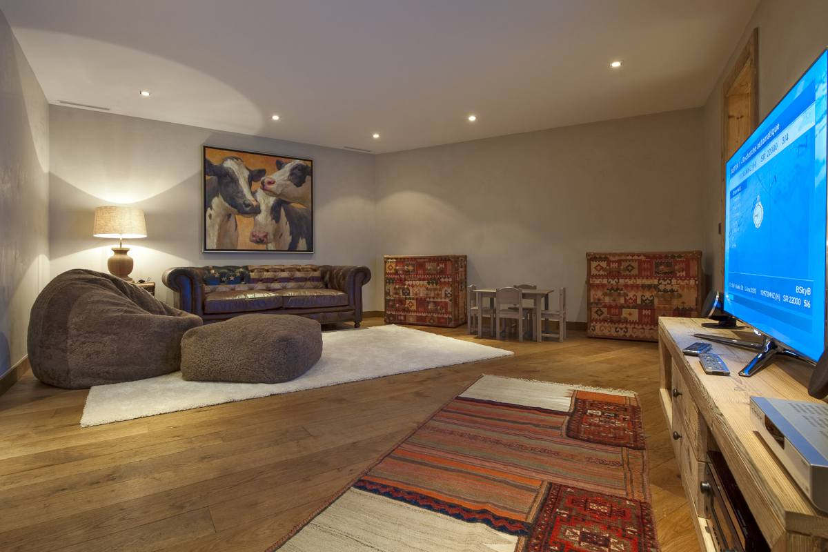 Cinema room with comfortable seating in Chalet Sirocco at The Alpine Estate in Verbier