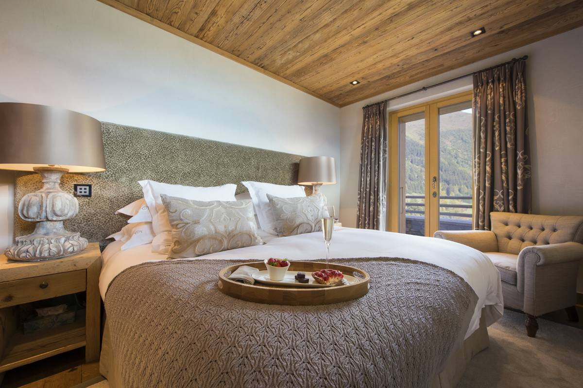 Double bedroom with terrace access in Chalet Norte at The Alpine Estate in Verbier